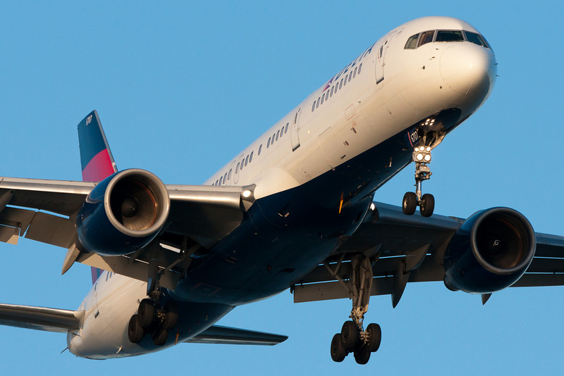 A Delta 757 makes an evening arrival at Boston.