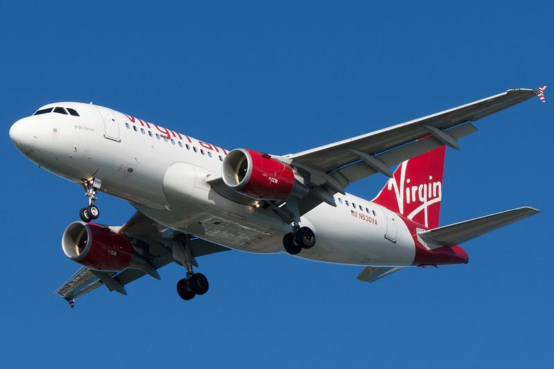 A Virgin America A319, Gogo Dancer, on final for runway 27.