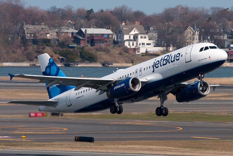 The new JetBlue color scheme departs Logan Airport.