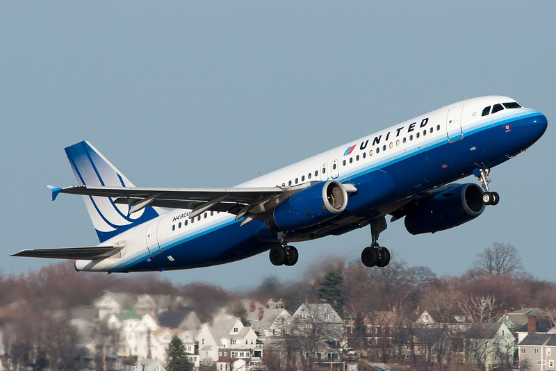 A United Airbus A320 leaves Logan for different pastures.