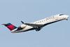 A Delta CRJ-200 departs Logan.