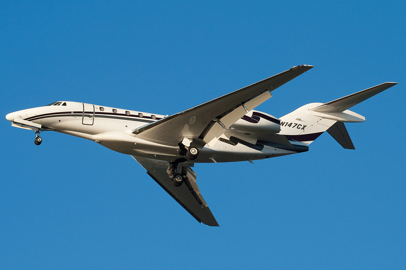 A cool Citation X on final for runway 27.