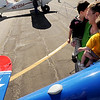 "Alan Mills holds his boys, Tyler, 3 and Cody, 1, as mom, Siew Gin Mills photographs them next to a vintage plane.<br /> Boulder Municipal Airport hosted the 6th annual Airport Day on Saturday.<br />  For more photos  a video from airport day, go to  <a href=""http://www.dailycamera.com"">http://www.dailycamera.com</a>.<br /> Cliff Grassmick / June 18, 2011"