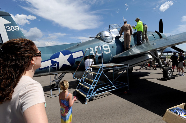 "People wait for passengers that just took a ride in the Avenger torpedo dropping WWII aircraft.<br /> Boulder Municipal Airport hosted the 6th annual Airport Day on Saturday.<br />  For more photos  a video from airport day, go to  <a href=""http://www.dailycamera.com"">http://www.dailycamera.com</a>.<br /> Cliff Grassmick / June 18, 2011"