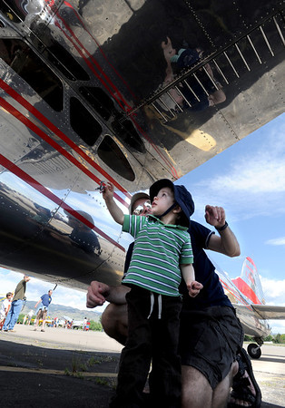 "Brian Wahlert and his son Ben, 2, check out  a Cessna from the 1950's.<br /> Boulder Municipal Airport hosted the 6th annual Airport Day on Saturday.<br />  For more photos  a video from airport day, go to  <a href=""http://www.dailycamera.com"">http://www.dailycamera.com</a>.<br /> Cliff Grassmick / June 18, 2011"
