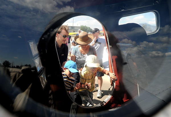 "People look inside the 1943 Beechcraft SNB-S/UC 45 J, WWII aircraft.<br /> Boulder Municipal Airport hosted the 6th annual Airport Day on Saturday.<br />  For more photos  a video from airport day, go to  <a href=""http://www.dailycamera.com"">http://www.dailycamera.com</a>.<br /> Cliff Grassmick / June 18, 2011"