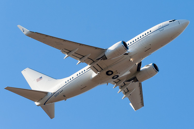 This is a US Air Force BBJ (C-40 Clipper) that is painted in a fairly nondescript paint scheme. Seen departing runway 6.