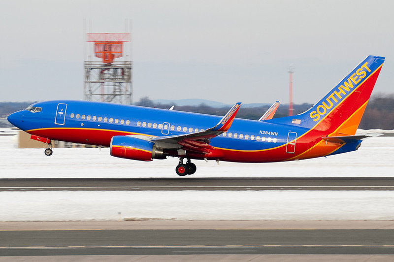 This Southwest 737 lifts up from the pavement of runway 33.