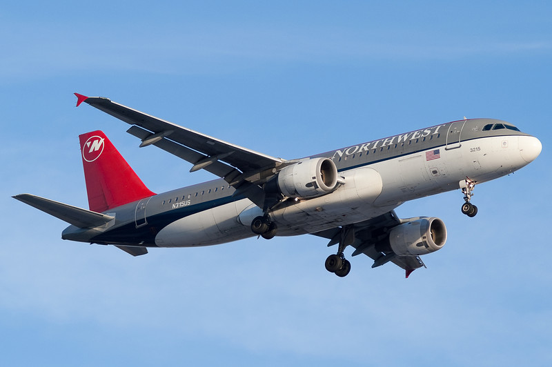 A Bowling Shoe Northwest A320 on final for runway 24.