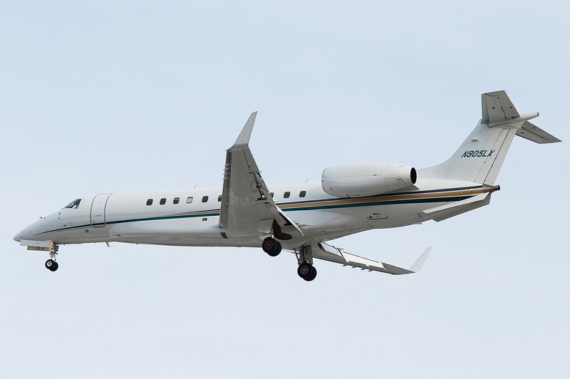A private Embraer jet on final for runway 6