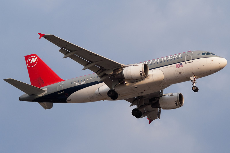 A Northwest A319 on final for runway 24.