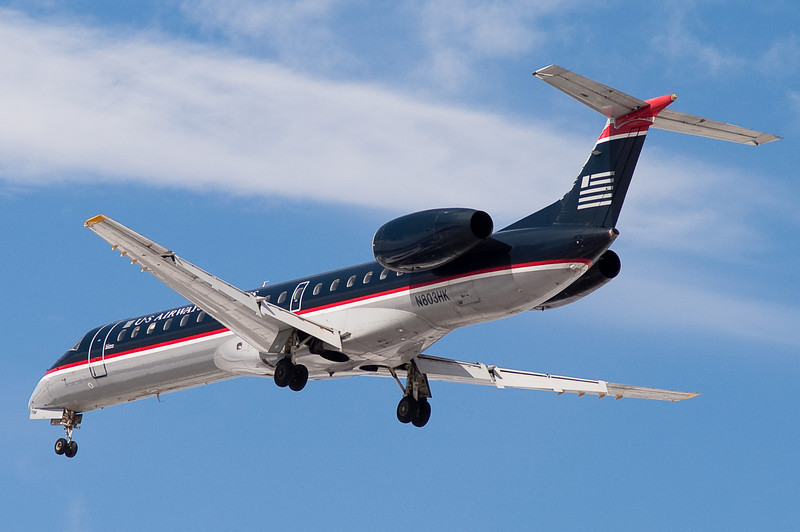 A US Airways Express E-145 on final to runway 33.