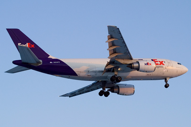 A Fedex A310 with no wing fences on final for 24.