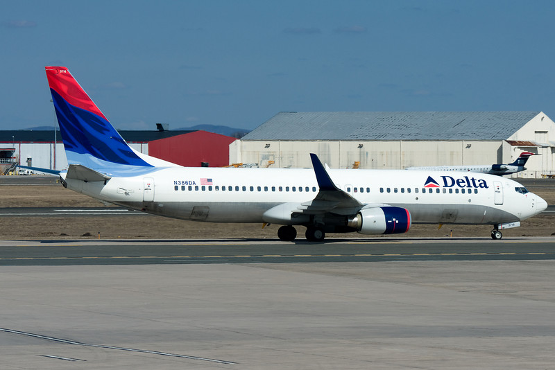 This DL 737 is taxiing to its gate at terminal A.