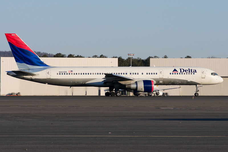Rolling down runway 6 for this Delta 757.