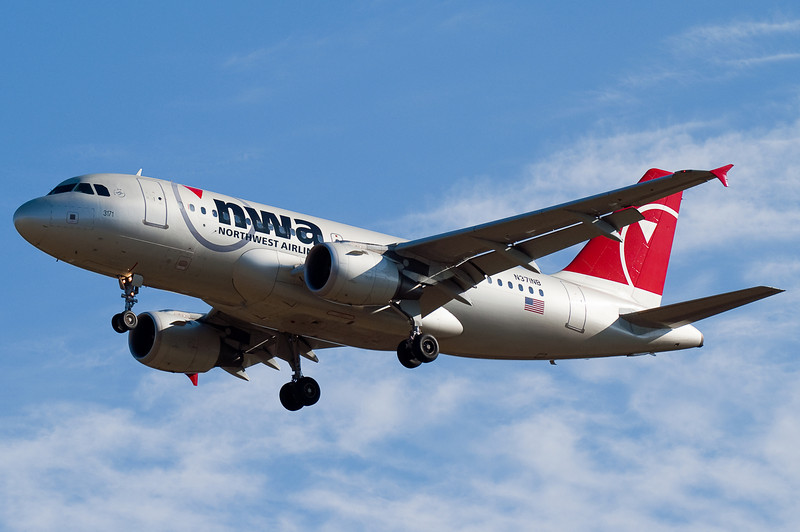 A Northwest Airbus from Minneapolis on short final for runway 6.