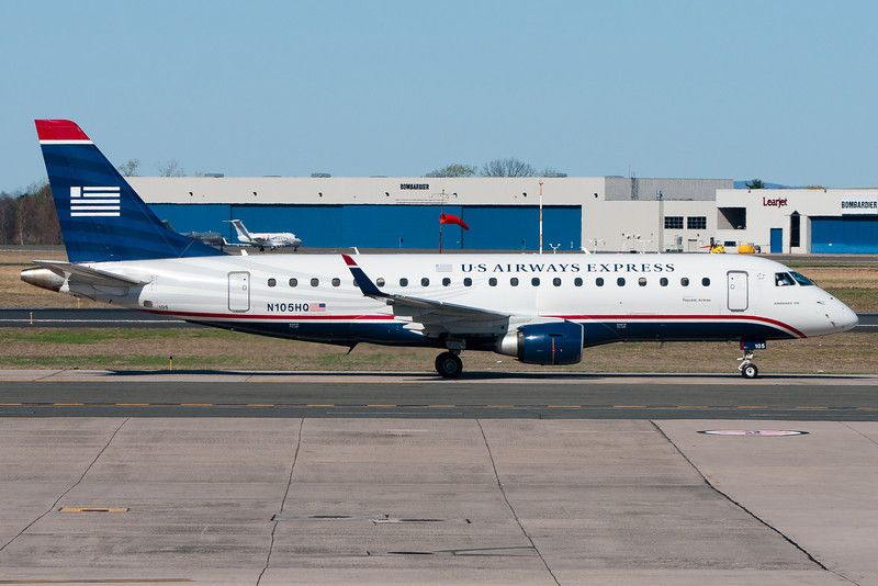 A US Airways E-175 heads for its gate after arriving at BDL.