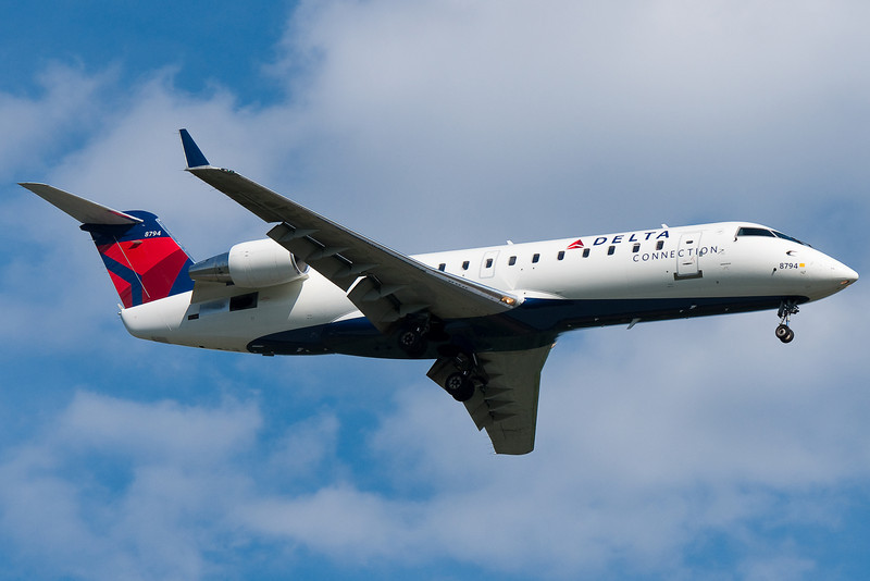 A Pinnacle CRJ now in Delta colors on final for runway 24.