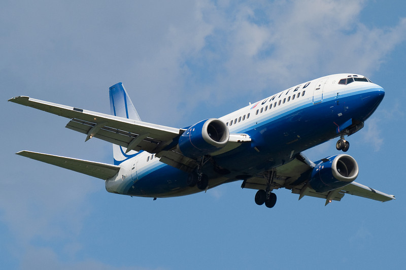 A United 737 on final for runway 24.