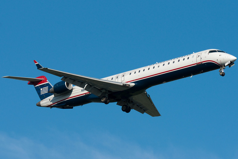 The US Airways Express CRJ-900 is on final for runway 24.