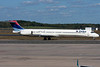 A Delta MD-88 is taxiing towards terminal A.