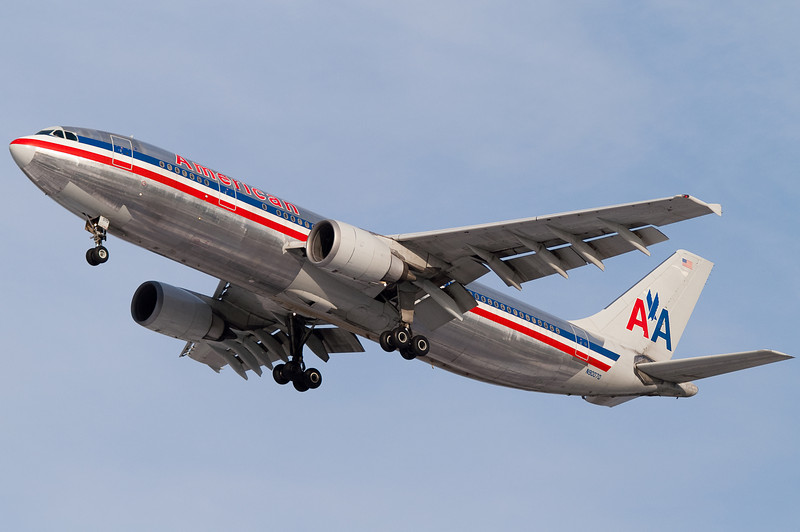 Unfortunately you don't see these anymore - the American Airbus A300 on final to 33 from San Juan.