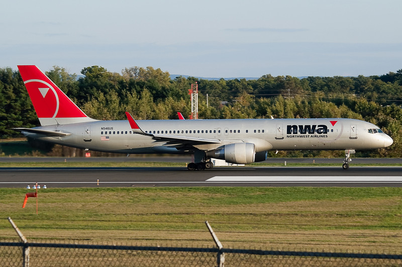 Taking off from runway 24 is Northwest 98 to Amsterdam, a wingletted 757.