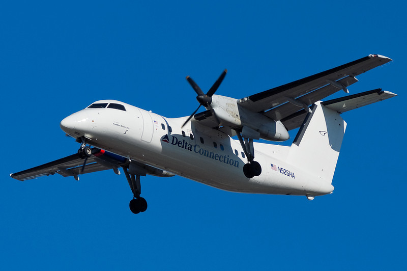 Another one of the short lived Freedom Air Dash-8s, and this one never even really got a paint job.