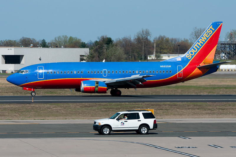 Who is winning this race? My bet is on the Southwest Airlines jet.