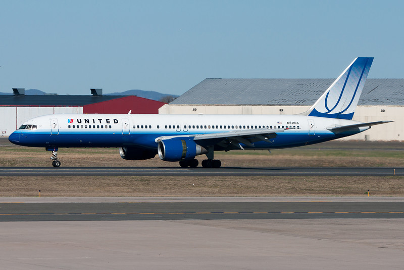 The United 757 rolls out runway 33 after arriving from Chicago.