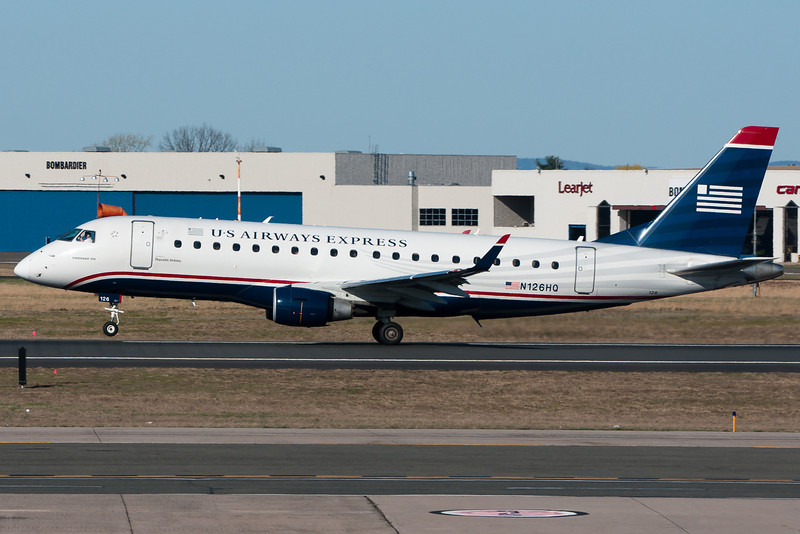 Rotating for takeoff on runway 33 for this US Airways Express E-175.