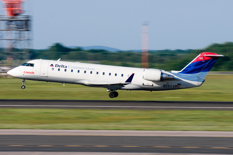 A Delta CRJ takes off from runway 33.