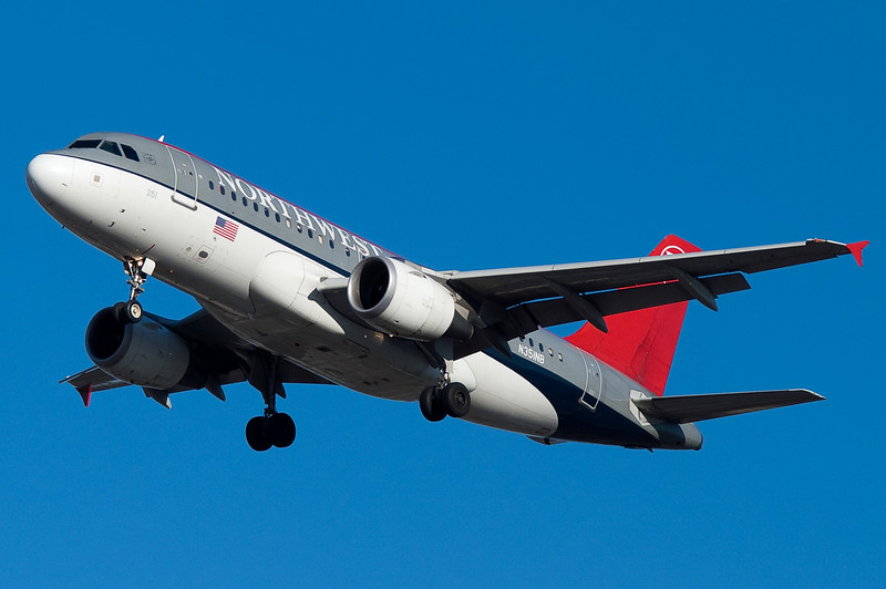 An old livery Northwest A320 on final for 33.
