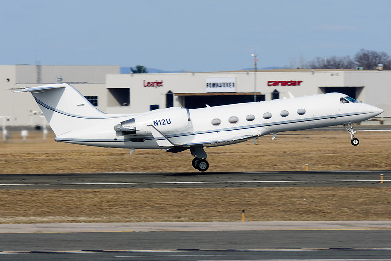 United Technologies' Gulfstream IV taking off from runway 15. Runway 15 usage is rare at Bradley, especially when 24 is open.