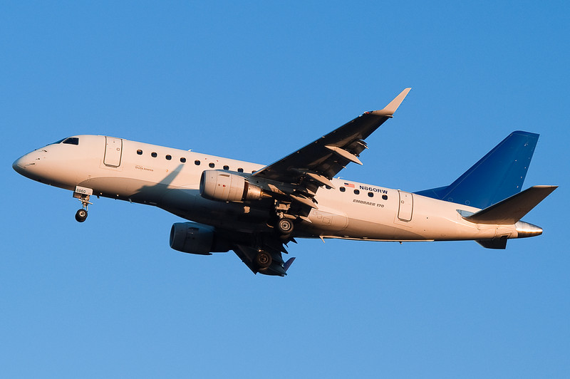 A sunset landing for this ERJ.