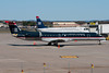 This US Airways Express Embraer is parked in front of the gate. A US Airways Express E-175 is seen in the background.