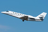 A Cessna Citation Sovereign taking off from runway 33 at BDL.