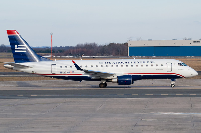 This US Airways Express ERJ-175 is taxiing towards the gates.