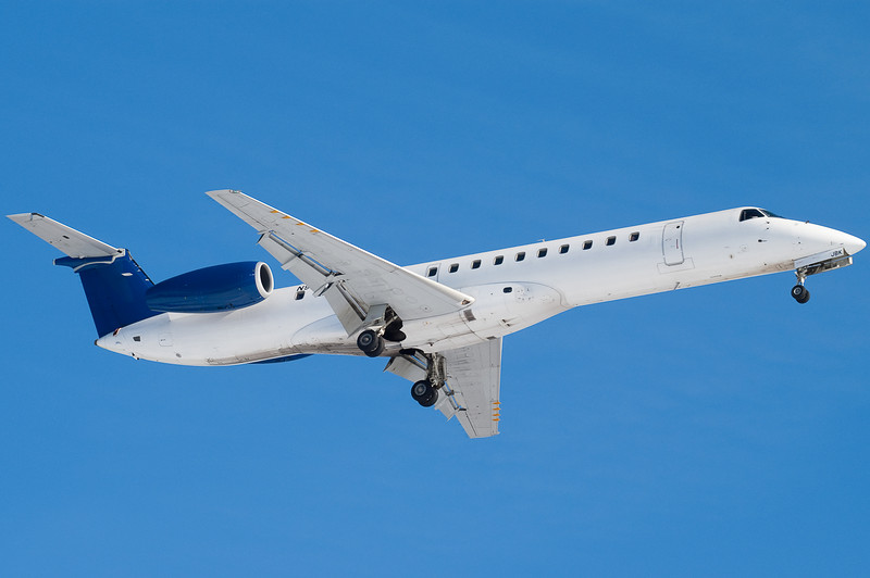 A non-branded Embraer 145 on final for 24.