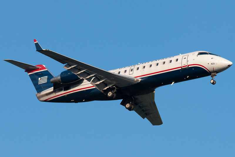 Another US Airways CRJ-200 on final for 24.