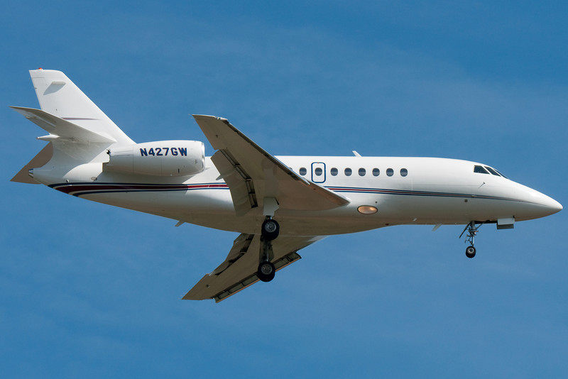 A Falcon operating an Executive Jet Management flight on final to runway 24.