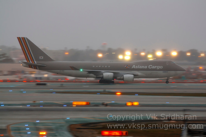 Shot on a drizzly evening at LAX this past March, this aircraft (Asiana Cargo registration HL7604) crashed off the coast of South Korea on 7/27/11.<br /> <br /> Best wishes to the families of the pilot and copilot and all others affected.