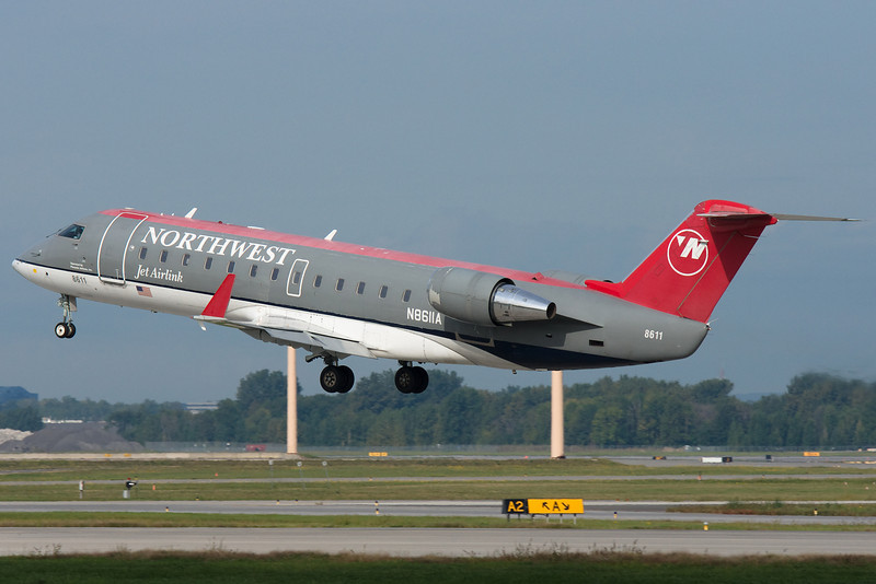 Old bowling shoe color scheme Northwest CRJ lifting up at Montreal.