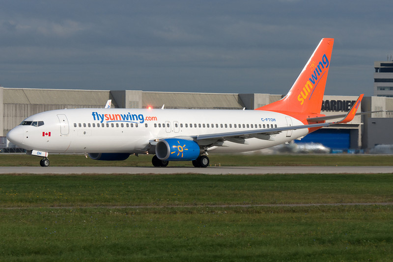 Sunwing is a flashy color scheme. Rolling down runway 24L at Montreal.