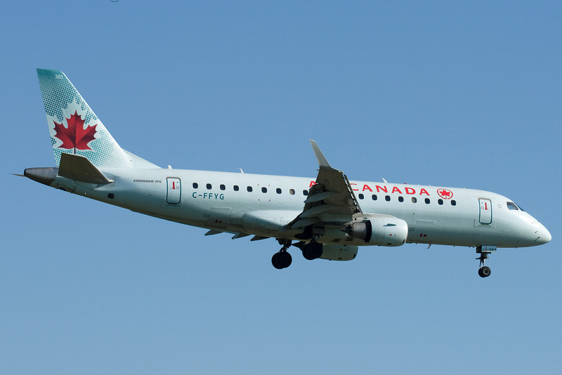 Lots of these guys at Montreal. Air Canada Embraer E175 on final for 24R.