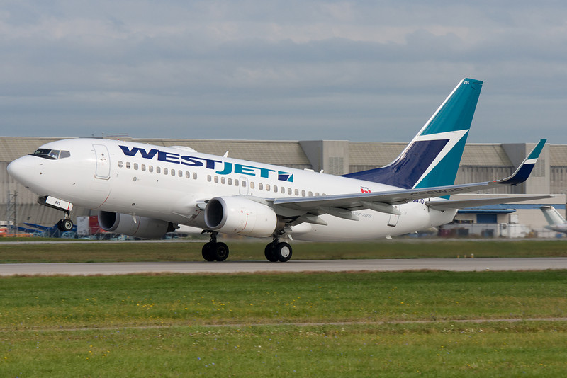WestJet 737 rotating up from 24L at Montreal.