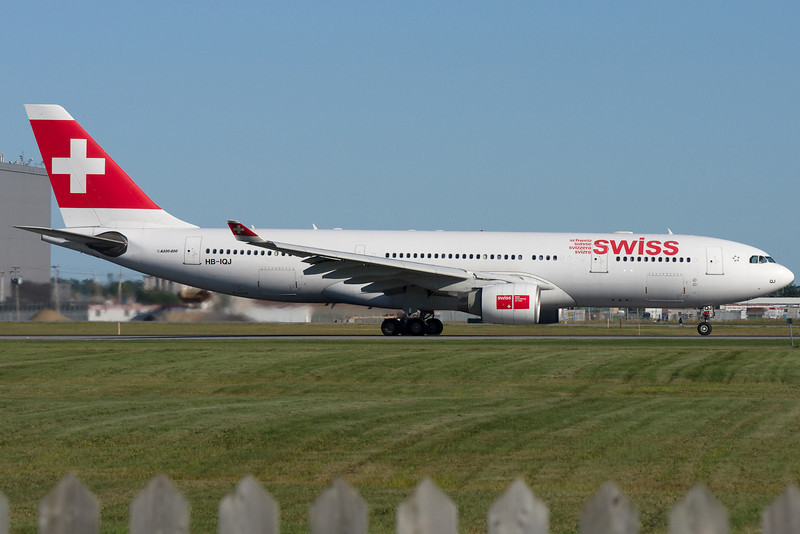 Swiss International A330 rolling down 24R for departure at Montreal.