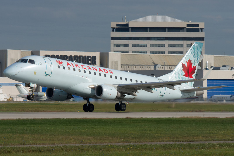 Embraer E-175 for Air Canada rotating from runway 24L at Montreal.