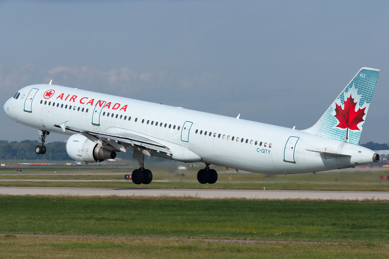 Airbus A319 for Air Canada lifting up from runway 24L at Montreal.