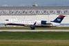 US Airways Express rotating up from runway 24L at Montreal.